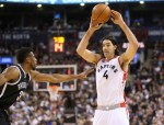 Jan 18, 2016; Toronto, Ontario, CAN; Toronto Raptors forward Luis Scola (4) passes the ball as he is guarded by Brooklyn Nets forward Thaddeus Young (30) at Air Canada Centre. The Raptors beat the Nets 112-100. Mandatory Credit: Tom Szczerbowski-USA TODAY Sports