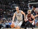 SAN ANTONIO, TX - DECEMBER 30:  Manu Ginobili #20 of the San Antonio Spurs handles the ball against Allen Crabbe #23 of the Portland Trail Blazers during the game on December 30, 2016 at the AT&T Center in San Antonio, Texas. NOTE TO USER: User expressly acknowledges and agrees that, by downloading and or using this photograph, user is consenting to the terms and conditions of the Getty Images License Agreement. Mandatory Copyright Notice: Copyright 2016 NBAE (Photos by Mark Sobhani/NBAE via Getty Images)